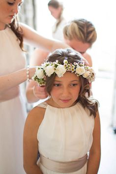Flowergirl wearing a floral crown.  Photography by http://www.greenphotographic.com/