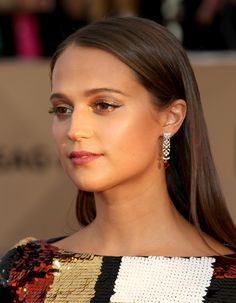 Louis Vuitton earrings worn by Alicia Vikander at the 2016 Screen Actors Guild Awards.