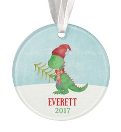 Personalized Christmas Ornament. This will be a cherished keepsake for many years to come. All of my ornaments are custom made and are one of a kind. The artwork is heat fused to the porcelain, it will not peel, crack, or fade. This is not a decal.  ---------Ornament Details--------- Each ornament comes attached with a ribbon for hanging. Free gift box Measures approximately 2.75 in diameter Made out of porcelain ceramic The artwork is permanently fused to the ornament (This is not a decal)…