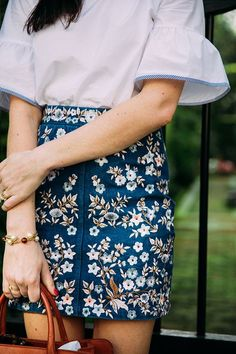 Embroidered denim skirt. I cannot even imagine a more perfect skirt. Small embroidered flowers on denim are very feminine/cute.