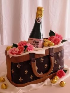 Designer Purse Cake with chocolate champagne bottle, sugar dough flowers and homemade bon-bons. Design by Sharon Zambito of Sugar Shack. Esther Simkin Designer Cakes (954) 309-1942.
