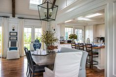 Open to both the kitchen and great room, the dining room offers comfortable seating and elegant furnishings to enjoy meals with friends and family. #HGTVDreamHome