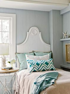 We love these beadboard walls painted in a cool gray-blue setting off the royal-looking headboard. | Photo: Michael J. Lee | thisoldhouse.com
