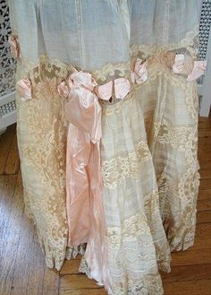 lace curtains with pink ribbon!