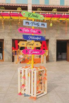 Photo of Cute mehendi decor idea with direction boards - Decoration Desi Wedding Decor, Wedding Hall Decorations, Backdrop Decorations, Wedding Signs, Wedding Entrance, Wedding Mandap, Wedding Ideas, Wedding Receptions, Mehndi Stage Decor