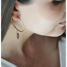 We are loving our new Brass Hoop Earrings with an antique glass dagger pendant! A fresh take on the classic hoop.