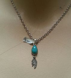 Mini feather torquoise pendant sterling silver by youareoutthere $45