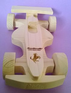 Wooden car wooden toys wooden race car, race car for kids in solid pinewood made entirely by hand with the technique of the scrollsaw on wood . The object has dimensions 2,4 of height , 5,5 of width and 9,8 of length. The finish is made with water based primer paint transparent. The wood used is from certified FSC plantations and the paints used , strictly water from the finish to beeswax , comply with national and European quality standards as they are non-toxic and free of substances…