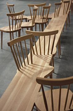 Stuhlhockerbank | Yvonne Fehling & Jennie Peiz - A group of chairs and a bench brought together to create bench-chairs... even the chairs that are outside the long wooden plank are connected.... it is indeed one piece.... yikes!