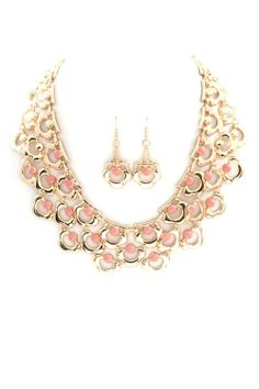 Love the pop of coral in this gold bib necklace and earring set