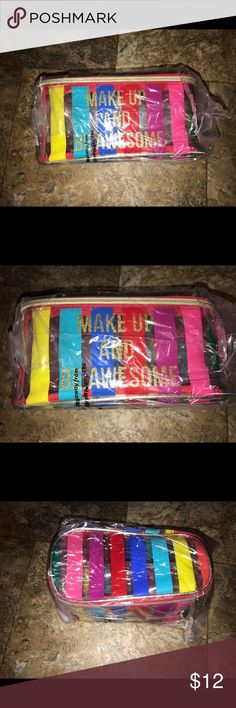 At make up bag makeup and be awesome NWT Make up and be awesome charming Charlie make up bag  Approx measurements 8 1/4 by 4 1/4 Let's bundle !  10% off on ANY two items purchased AND shipped together.  15% off ANY three items purchased AND shipped together! Accessories