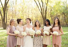 I LOVE these bridesmaid dresses- mismatches fabric and styles in champagne-y colors.