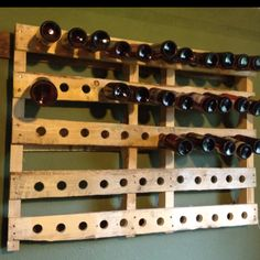 Old pallet upcycled to a beer bottle rack for home brewers.