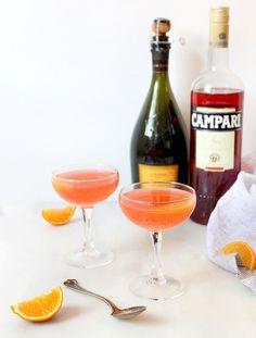 Campari Mimosa | 4 oz sparkling wine, 2 oz Campari, 2 oz orange juice, orange slice for garnish. In a glass pour sparkling wine and Campari. Top with orange juice and orange slice.