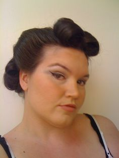 My attempt at victory rolls, and pin up eyeliner.