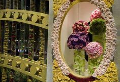Flowers adorn the Royal Gates at the main entrance during the preview day at the Philadelphia Flower Show on Friday, March 1, 2013.
