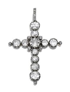 DIAMOND PENDANT, CIRCA 1880. Designed as a Latin cross set with cushion-shaped and circular-cut diamonds in cut-down collets, the pendant bail similarly set.