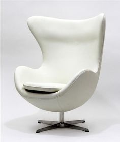 """Delight in perfect symmetry with the harmonious Arne Jacobson Egg Chair. Designed with sprawling wing tips and amorphous form, the Egg Chair is a study of opposites built from the most exacting design specifications. Adorn yourself with precision as you embark on a more sophisticated state. This item is a high quality reproduction of the original. Product Dimensions 35""""W x 42""""H x 31.5""""D"""