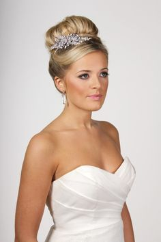 A sweeping high bun adds height and drama to your bridal look, its great for tucking a hair piece at the front or the side.