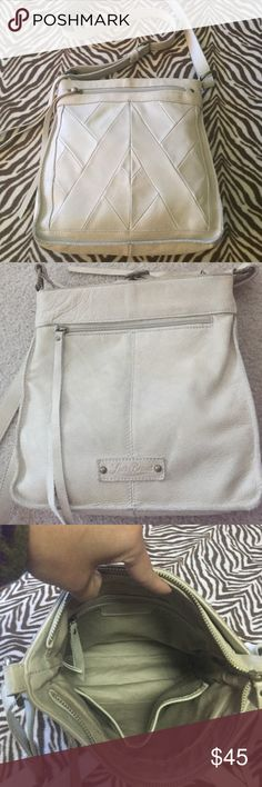 Lucky Brand Leather Crossbody Function and security in this  crossbody. Front and back deep zip pockets. Main zip closure inside 2 slip pockets and 1 zip pocket. Long zip leather pulls are both functional and stylish. Gold tone hardware. Adjustable strap can be shoulder bag. Gently used in great condition. Lucky Brand Bags Crossbody Bags