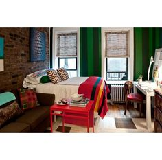 studio designed by Nick Olsen. Small studio in NYC, Chelsea, painted striped walls. White west elm parsons desk, bamboo blinds, striped blanket, hotel duvet cover, red painted coffee table studio apartment in NYC. Manhattan studio apartment. Studio apt.
