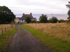 Path to house with Ynys Dulas out to sea