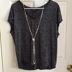 WHBM sleeveless shirt Generously sized and the fabric comes down over the shoulders to give a sleeve like appearance. Could be dressed up or down. Like new condition! It just shimmers in the light! Accepting reasonable offers but please, be respectful! ❤️ White House Black Market Tops Blouses