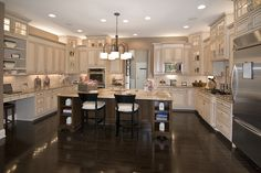Dream Kitchen; Almond/Cream Kitchen Cabinets with Chocolate Pin Glaze; Dark Contrasting Island; Dark wood floors