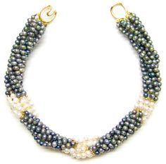 Helga Wagner Gray Fresh Water Pearls with three stations of white Fresh Water Pearls and Tiffany clasp.