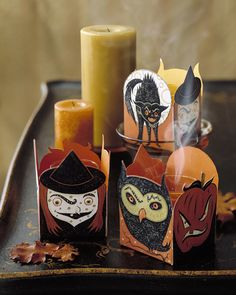 Create little boxes of horrors to use as spine-tingling decorations. Place glass votive holders with tea lights inside the containers, or fill them with candy or other little gifts.
