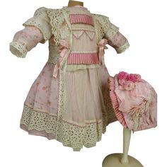 French pink flowered organdy dolls dress and matching bonnet from stairwaytothepast on Ruby Lane