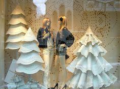 This doily-inspired window from Chanel's shop in Zurich (Christmas 2010) is a whimsical take on Christmas. It would probably cost a small fortune to recreate this display, but you could easily take some paper doilies and decorate your windows with them, mimicking snowflakes. You could even use a pair of scissors to transform paper doilies into actual paper snowflakes.