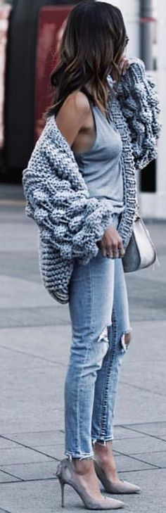 #spring #outfits woman wearing gray tank top and blue pants standing on sidewalk during daytime. Pic by @fashion.voyage