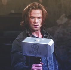 Sam holding Mjolnir. Seriously. This happened. It's like the world is out to just completely make my life.