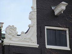 Amsterdam, ornament op grachtenpand