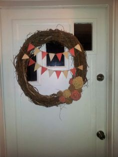 Wreath with burlap flowers and pennant banner
