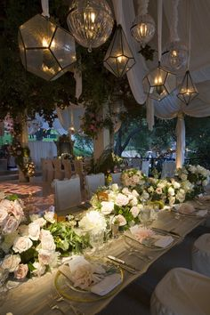 Inspiration for inside the ballroom  -I like the tall flowering trees, greenery  -I like the floral arrangements on the long head table. It resembles the 'runner/garland' look I like and would mix in some high elements and lots of candle light  -Gold accents  -I like the soft lighting and subtle spot lights  -Overall, this depicts the whimsical garden look I love