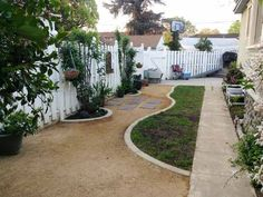 This Pomona, Ca reader wanted her side yard to look better, use less water, and be more dog-friendly. A new surface of decomposed granite set in undulating curves  and accented with plantings did the trick!
