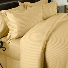 Stripe Gold Down Alternative Bed in a Bag. Wrap yourself in the Softness of the luxurious Egyptian cotton Beddings found in World Class Hotels. The ultimate in Bed in a Bag, these fine luxury bed linens are crafted from long staple Giza cotton grown in the Lush Nile River Valley since the time of the Pharaohs. Comfort, quality and opulence set our luxury bedding in a class above the rest. Elegant yet durable, their softness is enhanced with each washing.
