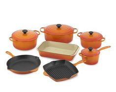 le creuset cast iron pots and pans. in orange, or teal, or white...