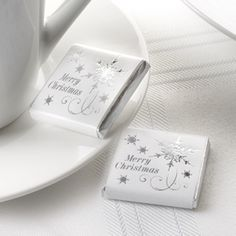 Add extra sparkle and decoration to your christmas tables or winter wonderland Christmas themed wedding or celebration.  These gorgeous milk chocolates are perfect to use as wedding favours, to scatter on the tables for guests to enjoy or serve on a saucer with a cup of tea or coffee.  Pack of 20 for £7.99.  33mm square.  From the Online Fuschia Boutique at www.fuschiadesigns.co.uk.