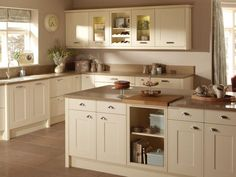 Image result for cream kitchen with white tiles and wooden worktop