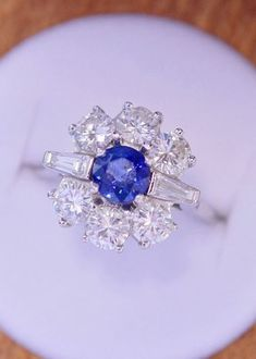 Love this unique, vintage sapphire engagement ring.