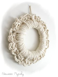 Crochet wreath. this link seems to be wrong but just look at this wreath made of white fabric strips.  We could do that!