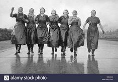 Scottish Herring Girls circa 1936 Linkning arms on their way to work