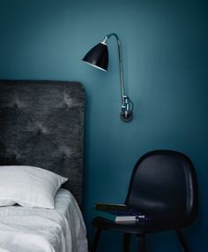blue wall and Gubi chair