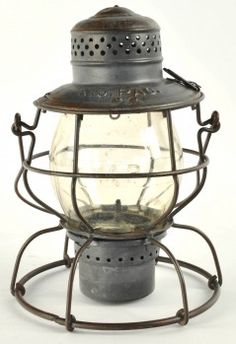 """Handlan St. Louis tall globe lantern for the Missouri Pacific Railroad, last patent date 1917 and is equipped with bail lock. Dome is marked Mo. Pac. and clear cast CNX globe is marked M.P. size: 10"""" t."""