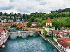 Unterbrucke bridge over Aare River and old houses in Bern Switzerland Switzerland House, Switzerland Summer, Switzerland Cities, Switzerland Itinerary, City Aesthetic, Travel Aesthetic, Beautiful Places To Visit, Wonderful Places, Places To Travel