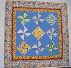 Pinwheel Quilted Table Runner Wall Hanging by ForgetMeNotQuilteds