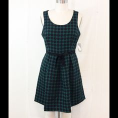 """Green with Black Polka Dots Love 21 Dress NWT Med Great dress for work or a night out. Sleeveless, fully lined, front and back darts, side seam pockets, cute bow in the front at the waist and a center back zipper. The length from the shoulder to the hem is 34"""". The hem is turned up 3"""" so it can be made longer if needed. Will fit a medium size 8-10. Love 21 Dresses"""